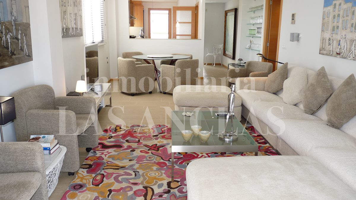 Spacious lounge with semi- open kitchen - penthouse flat in Santa Eulalia Ibiza for sale