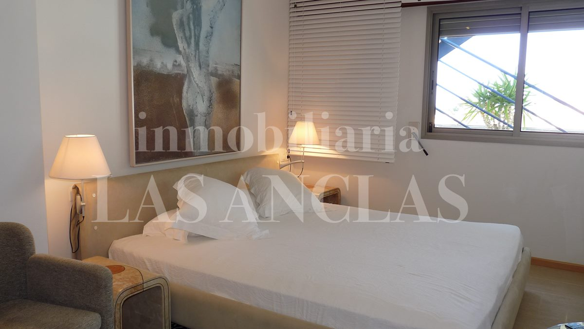 Spacious bedroom with roller shutters - penthouse flat in Santa Eulalia Ibiza for sale