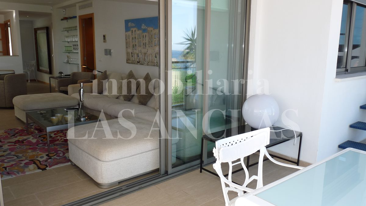 Access to the ample covered terrace from the living room - penthouse flat in Santa Eulalia Ibiza for sale