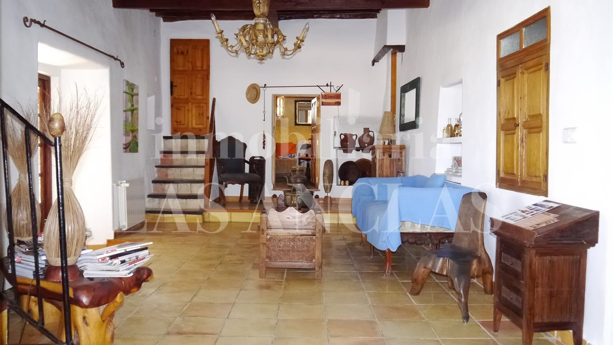 entrance hall with heigh ceilings decorated with Sabina wood beams - authentic finca mansion in San José Ibiza for sale