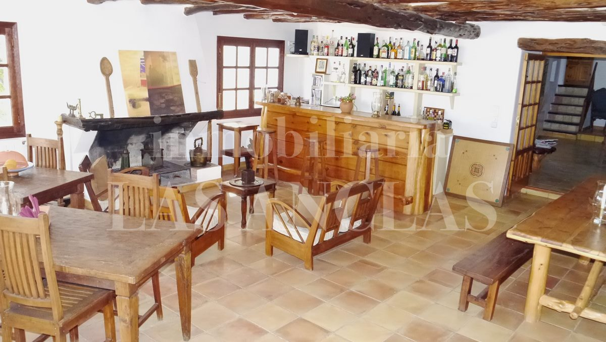 cosy living/dining room with fireplace - authentic finca mansion in San José Ibiza for sale