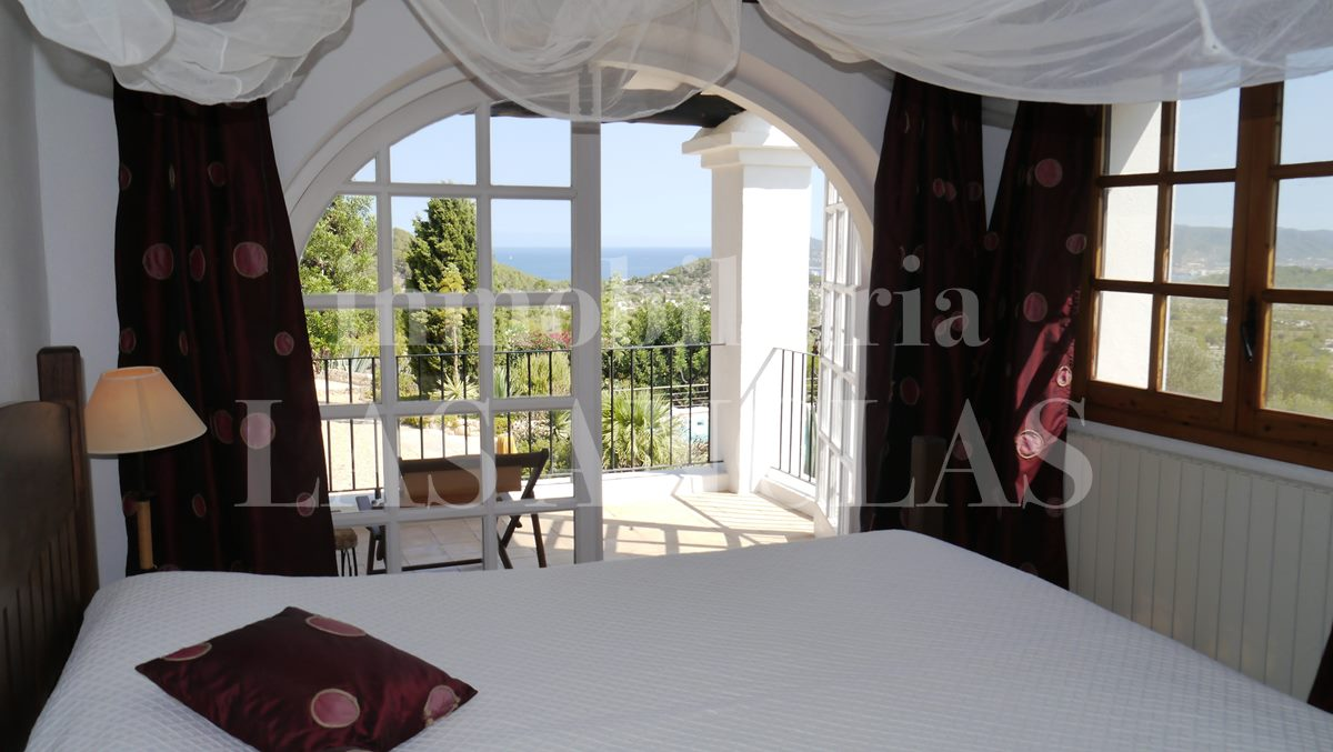 main bedroom with dreamlike views of the sea - authentic finca mansion in San José Ibiza for sale