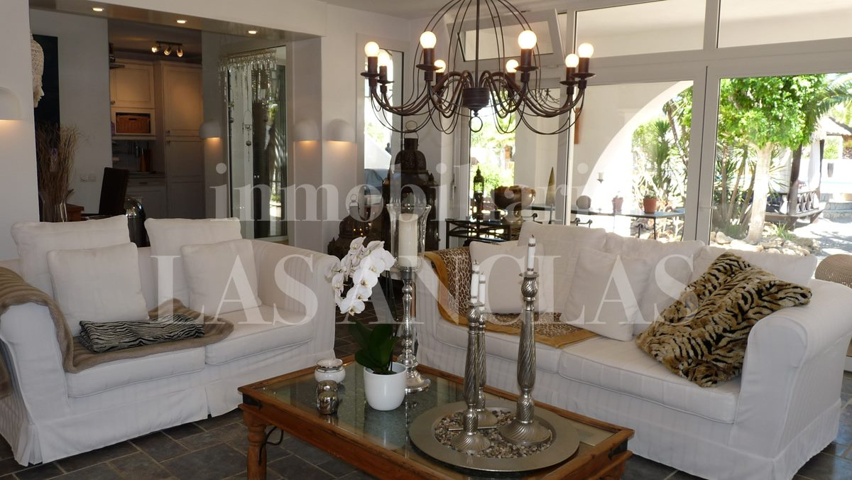 light lounge with kitchen in background - mansion / manor house in San José Ibiza for sale