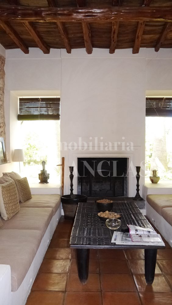 fireplace room with ceiling of nice-smelling Sabina wood - authentic finca mansion in San Lorenzo Ibiza for sale