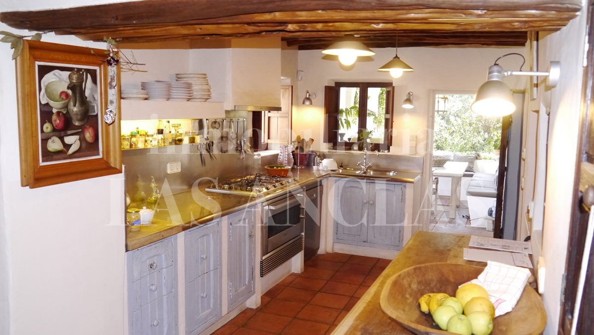 spacious fully-fitted kitchen with dining area & terrace - authentic finca mansion in San Lorenzo Ibiza for sale