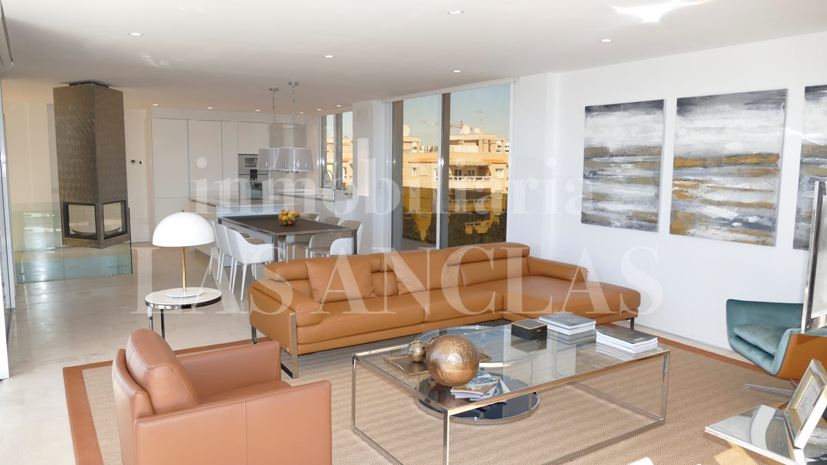 Impressive open-plan living-/dining room with kitchen	 - luxury penthouse flat in Talamanca Ibiza for sale