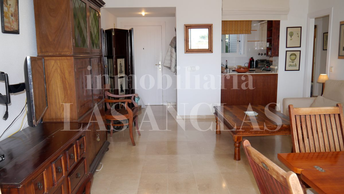 Living-/dining room with elegant limestone floors and semi-open kitchen  - flat / apartment near golf course Ibiza for sale
