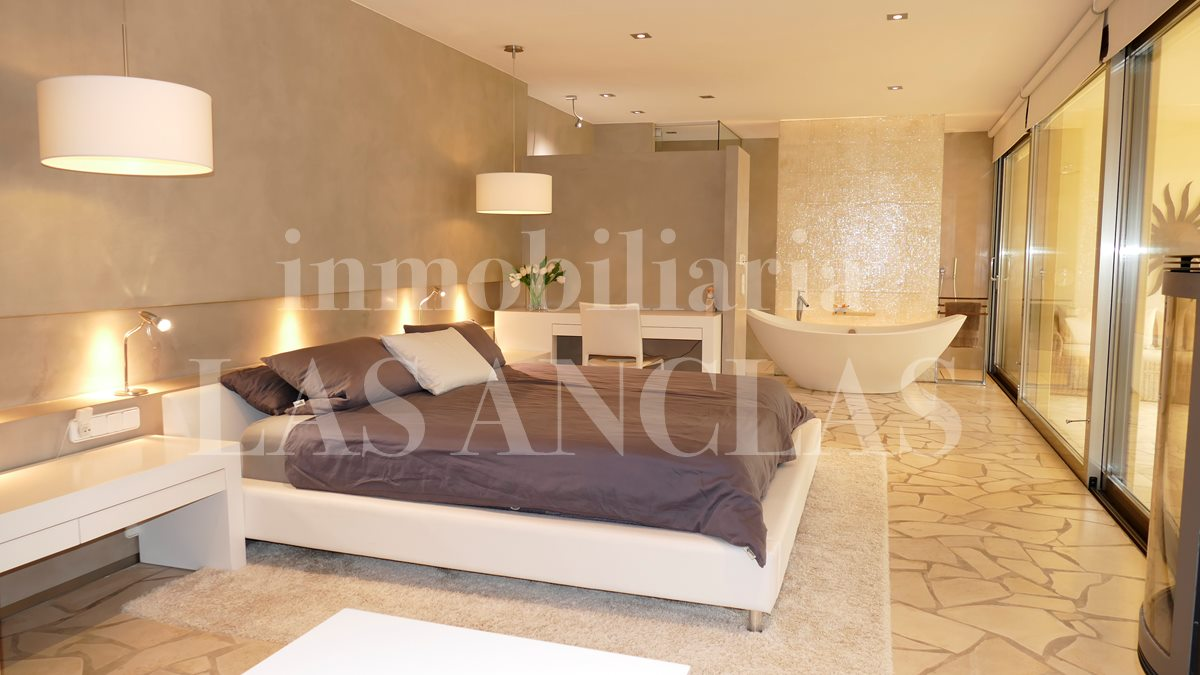 Stately master bedroom with fireplace and designer bathroom - luxury villa in Santa Gertrudis Ibiza for sale