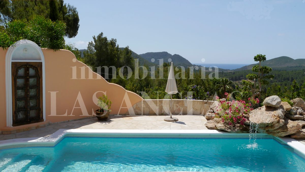 Heated Pool with a little waterfall and fantastic views of the sea  - villa in Santa Eulalia Ibiza for sale