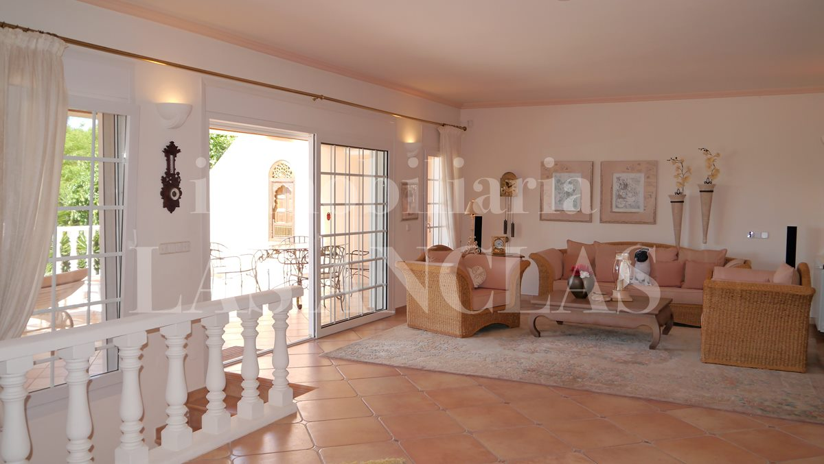 From the bright living room a staircase leads to basement - villa in Santa Eulalia Ibiza for sale