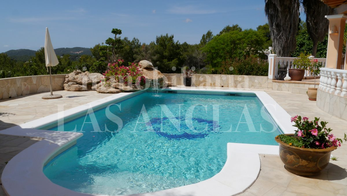 Pool area with a large sunny terrace and stunning views - villa in Santa Eulalia Ibiza for sale