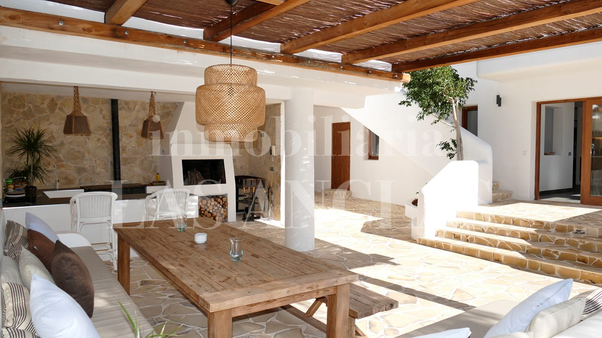 Charming outside kitchen on large covered terrace - luxury villa between Ibiza & San José for sale